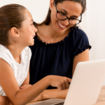 Mom helping student with online course